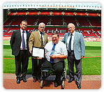Arnold being presented with the FCSI Award at Old Trafford